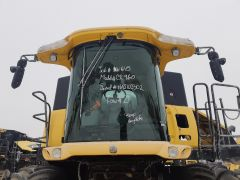 Complete cab off of 2006 New Holland CR960 combine. Overall 9/10 condition. Sold with one year warranty.