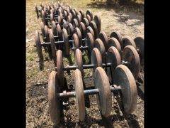 """3"""" steel packers from a Bourgault 5710 air drill. 10"""" spacing. Price is per packer, sold by the gang. Gangs of 5 & 4. 7/10 condition. Sold with warranty."""