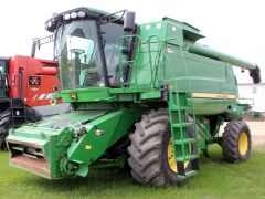 John Deere T670 combine for sale. 1386/1975 hrs, conventional, GPS-ready, Command Centre, AHHC, F/A, Y&M, powerfold hopper cover, v. good cond.