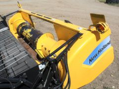 New Holland 76C 14' pickup header for sale. Floor & auger nice, field lights, for NH. Single pt, 540 PTO. Good cond.