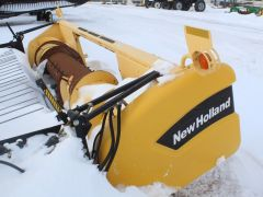 New Holland 76C 14' pickup header for sale. Very nice auger & floor, no dents, field lights, single point, for CR/CX.