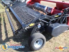 Swathmaster 16' pickup for sale. 9-belt, belts & teeth new, washers excellent, hyd dbl wg, AHHC, very nice pickup.