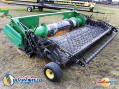 2004 Precision/John Deere 1300 complete 14' pickup header w/Swathmaster for sale. Hyd windguard, excellent auger, single point hyds, good condition.