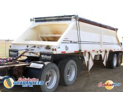 Good used 2010 Midland MG29MX2000 29' bottom-dump trailer for sale at Combine World in Saskatoon, SK.