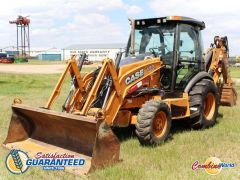 "2012 Case 580 Super N 4x4 loader backhoe for sale in Saskatoon at Combine world. Nice unit. 5941 hrs, extend-a-hoe, 4WD. (Front LHS, main image/profile picture. ""Satisfaction Guaranteed Since 1986"" watermark badge in lower left corner.)"