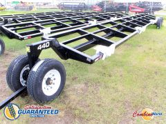 New Industrias America tandem axle header transport for sale. 40' dolly-style transport. 4 saddles, pin hitch.
