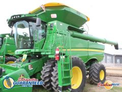 John Deere JD S690 combine for sale. 1576/2097hrs, GreenStar 3, Contour Master, Y&M, integrated steering, mapping, Big Top w/cover.