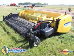 New Holland 790CP auger header with belt pickup. Good belts & auger, floor excellent. For CR/CX.