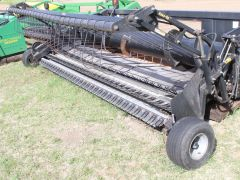 Rake-Up 14' pickup for sale. 8 belts, decent condition, hyd double windguard, Rake-Up bars very good. Nice pickup.