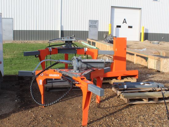 The TireGrabber heavy equipment tire handler hydraulic attachment. Change tires safely & easily. Attaches to any existing hyd system.